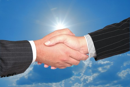 Business handshake on sky background. successful transaction. photo