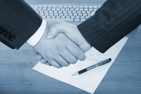 businessmens' handshake over contract and pen in blue tone Stock Photo - 4235639