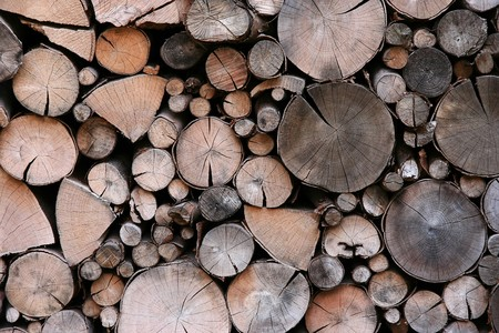 Stack of pile of firewood, wooden background photo