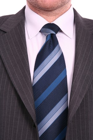 formalism: businessman in bleu tie and gray suit, close up Stock Photo