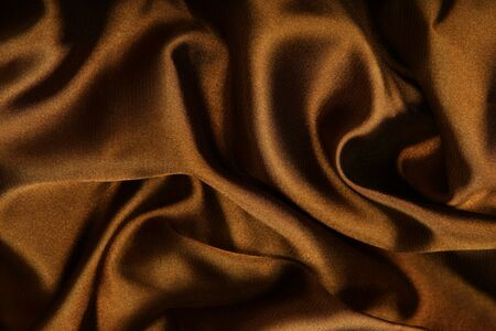 Brown smooth textile as abstract background photo