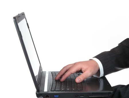 Businessman hand on the laptop's keyboard isolated on white background Stock Photo - 4272234