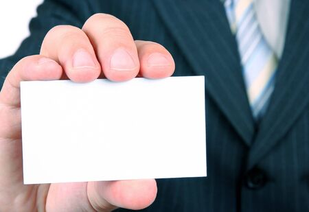 show cards: Busimessman is holding a business empty card  Stock Photo