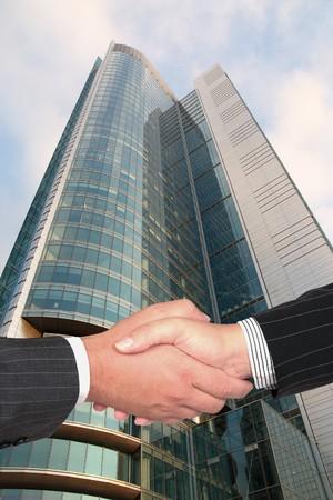 Business handshake on modern city background  photo