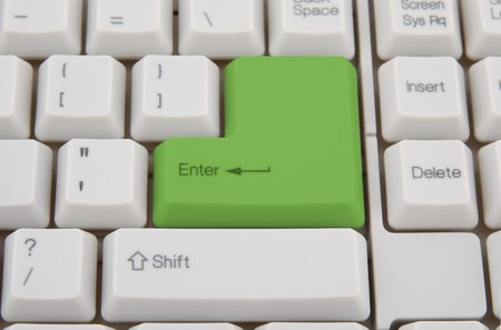 Computer keyboard with  green key, as background Stock Photo - 4408880