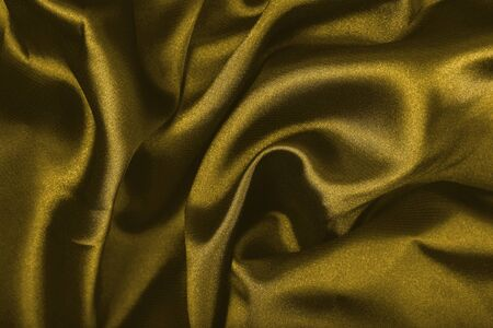 Dark old golden textile as background abstract photo