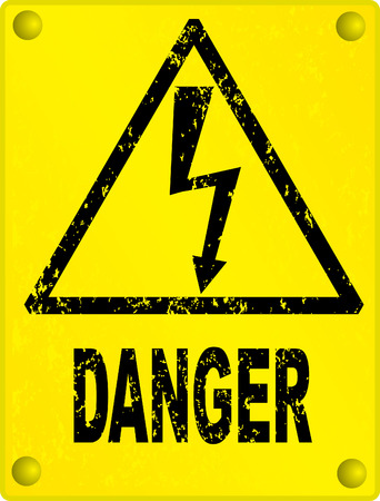 danger ahead: High voltage - grunge sign on yellow metal board