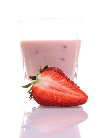 delicious strawberry milkshake with red fruits behind  photo