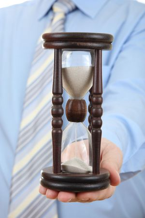 Businessman with hourglass Stock Photo - 4952925