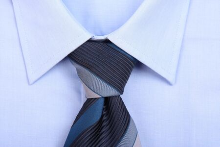 Blue tie with blue shirt, close up photo