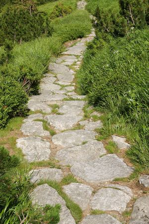 Stone path in the mountains photo