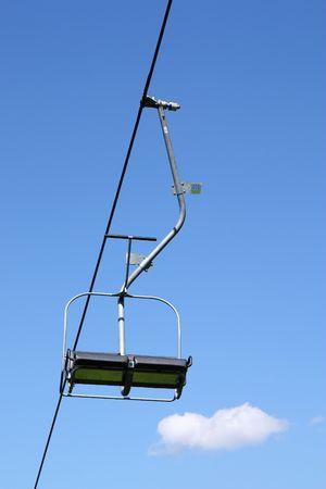 ski lift on blue sky background photo