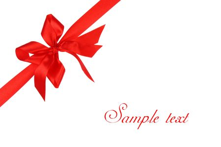 Decorative red bow ribbon on white background with copy space photo
