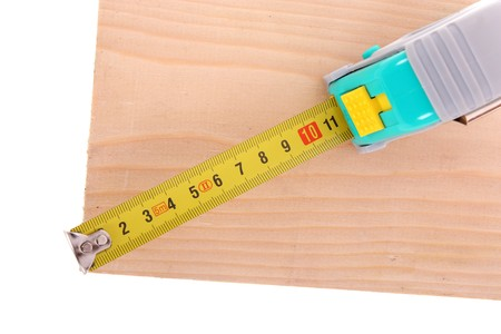 Measuring wood with yellow tape photo