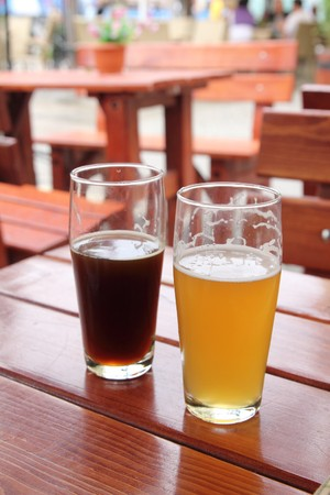 Two glasses of beer on wooden desk photo