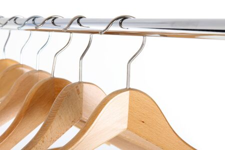 clotheshanger: wooden clotheshanger isolated on white background Stock Photo