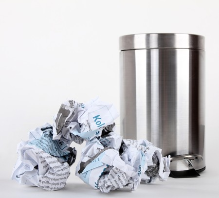 a opened pedal bin and rubbish isolated on white background photo