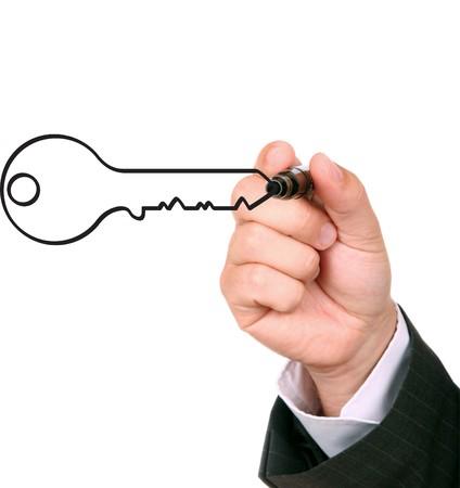busimessman drawing key to succes photo
