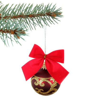 Spruce branch with christmas decor red balls with red bow photo