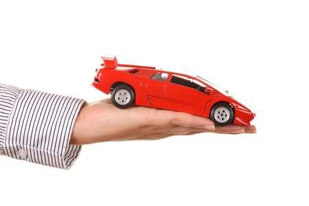 Woman hand with holding red sports car photo