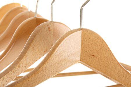clothes rail: coat hangers on a clothes rail, close up