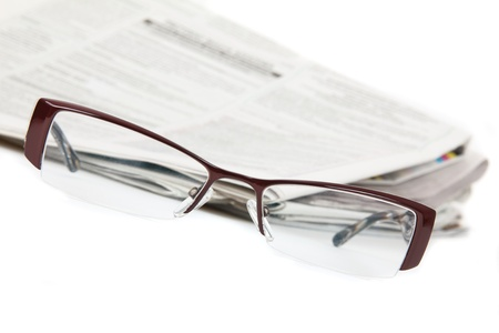 commentary:  Modern eyeglasses and newspaper Stock Photo