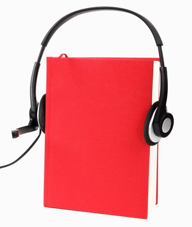 teaching music: Red book with headphones, concept of audio books