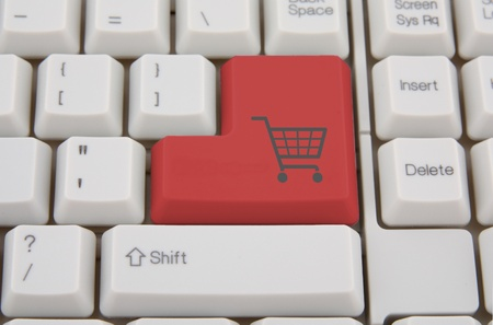 Shopping on-line , red key with basket symbol Stock Photo - 8899528