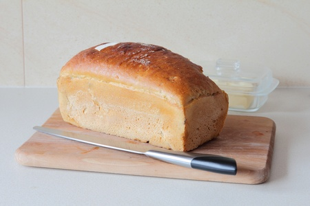 worktops: stock photo : bread with knife on kitchen worktops