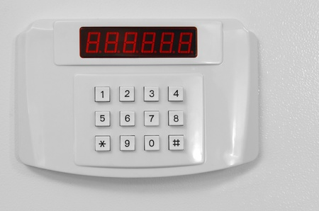 Small home or hotel wall safe with keypad, closed door Stock Photo - 9496820