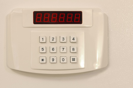 Small home or hotel wall safe with keypad, closed door photo