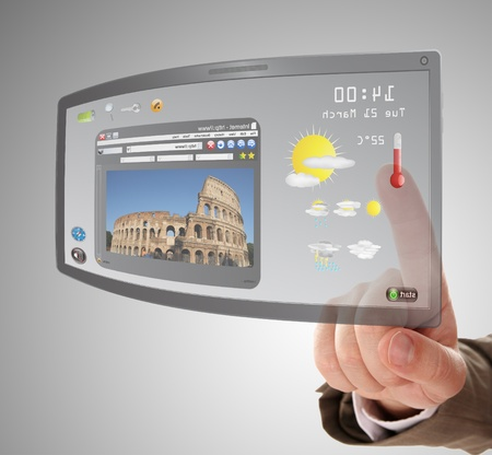 futuristic man: hand searching a information on touchscreen tablet