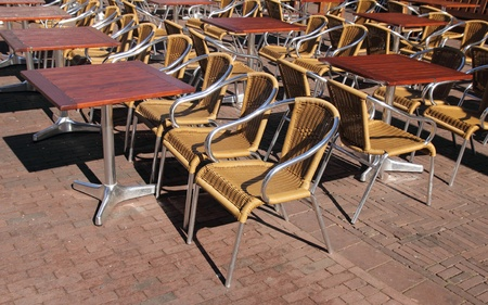 Many empty chairs in outdoor restaurant photo