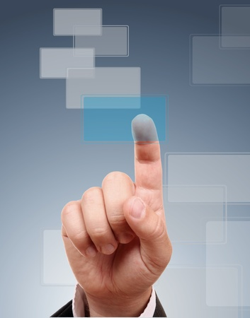 The hand pressing one blue button Stock Photo - 9899867