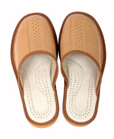 houseshoe:  pair of brown slippers for man isolated on a white background