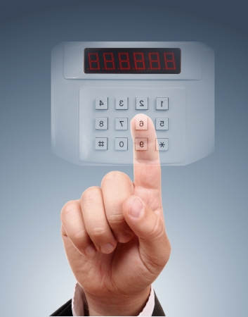 alarm security: Man entering code