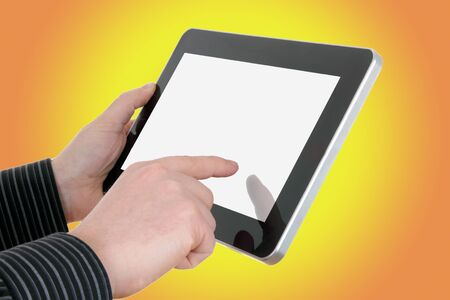 resemble: businessman hands with tablet on yellow background, image was heavily modified, all buttons, led were removed and it does not resemble any particular device Stock Photo