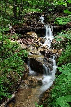 Small waterfall in mountains  photo