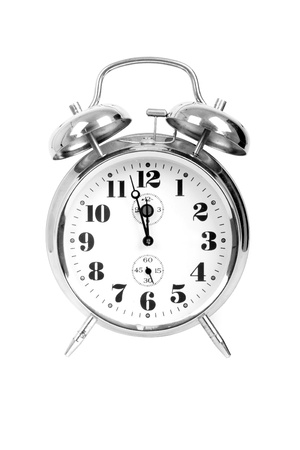 Vintage metal clock isolated on white background