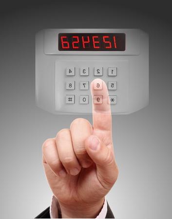 entry numbers: Man entering safe or door code