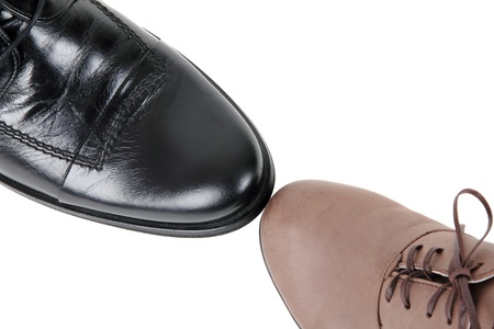 Black male shoe and brown female shoe isolated on white Stock Photo - 11727219
