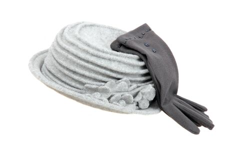Gray hat and gloves on a white background. photo