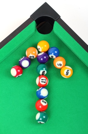 colored arrows laid with billiard balls photo