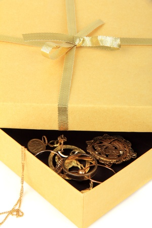 golden gift box with jewelry ,on a white background photo