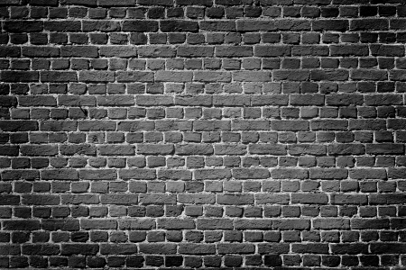 Old dark brick wall, texture background photo