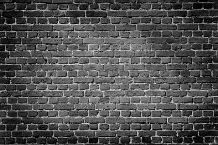 Oude donkere bakstenen muur, textuur achtergrond