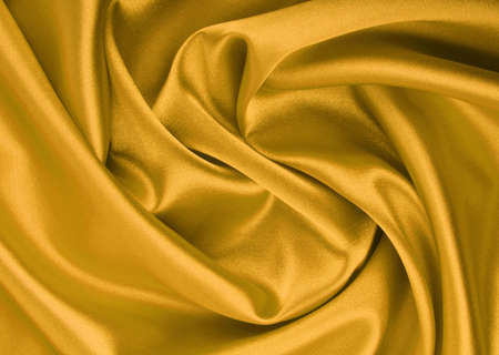 Golden satin textile background photo