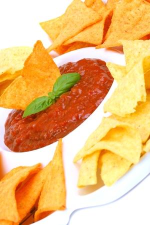 corn chip: Nachos and tomato dip