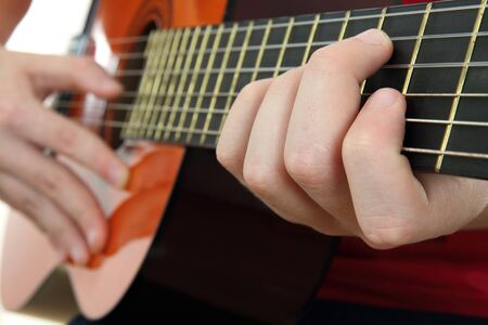 Acoustic guitar with hands. photo