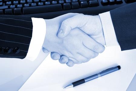 Business handshake on blue tone  photo